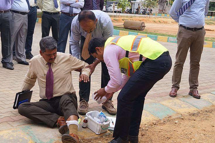 Karnataka police officers acting out a crime situation