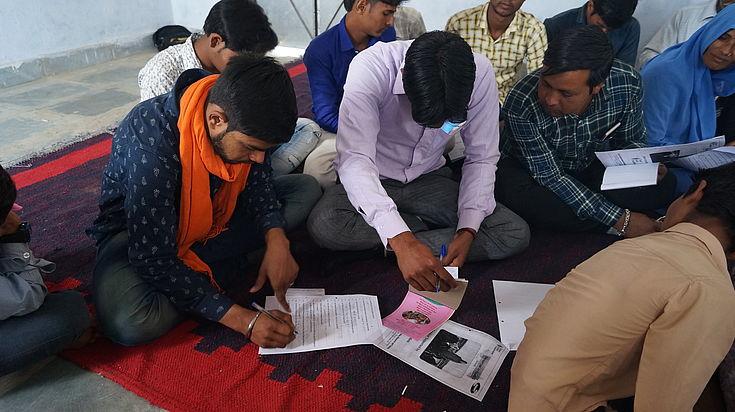 Sambhariya representatives fill in a survey